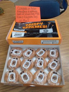 Reward/incentive for being #1 class in attendance...Krispy Kreme donuts with vampire teeth...school/classroom