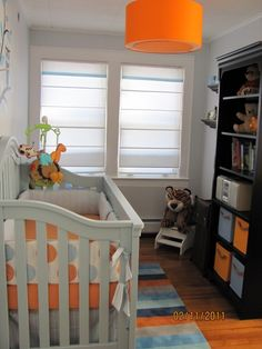 The orange lamp is adorable. Note - This room is smaller than our nursery.