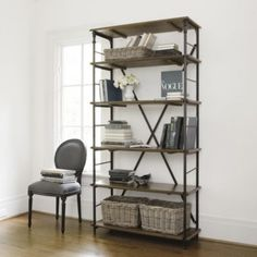 Toulouse Tall Bookcase | Ballard Designs - tall bookcases flanking the fireplace are another option. Large baskets on the bottom are for storage and shelves could house media equipment and books/decorative objects.