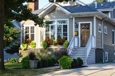 Inspired Living: Exterior Updates; This is exactly what I envision for my next home. I need those square planters.