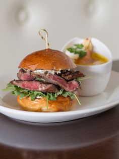 Grilled Ribeye with Balsamic Crème Fraîche, Fresh Horseradish and Pickled Ramps on a freshly baked Brioche bun at Paramour.