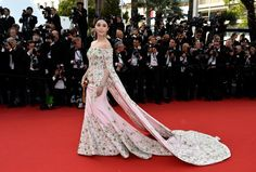 Fan Bingbing's glamorous in a light pink off-the-shoulder Ralph and Russo gown. With three long capes — coming off the sleeves and another from the shoulders — the actress brought drama in a girly way.