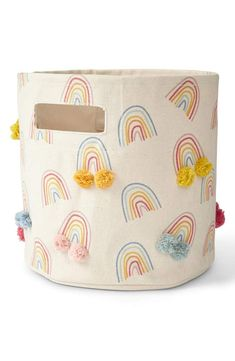 Tidy away books, toys, and craft supplies with ease with this adorable bin from Petit Pehr. Made of cotton canvas, its whimsical hand-sewn pom pom adds a touch of charm to any nursery or playroom. Rainbow Nursery Decor, Rainbow Bedroom, Bright Nursery, Nursery Room, Girl Nursery, Kids Bedroom, Baby Room, Rainbow Print, Rainbow Baby