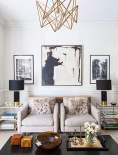 Contemporary living room with an intricate structured chandelier design