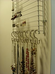 "Great (and for me) cheap way to organize and see your earrings and necklaces! Got a wire shelf I wasn't using (leftover!) and attached it to my WALL vertically! Add ""double"" shower curtain hooks to the bottom for necklaces. May need to hang another beside for my scarves, belts, etc. My shelf is about 36"" so I have PLENTY of space! Am going to figure out a way to also hang some bracelets and maybe even rings on this! Thanks Dave for helping me hang it!"