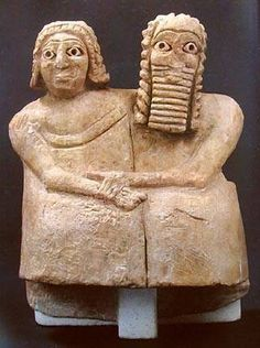 Devotional Statue Dating back to 2600 B.C.E. of what scholars believe is a married couple. The gypsum statue was found buried beneath the floor of a shrine at Nippur in Iraq and measures 3 1/2 inches wide at the bottom. The couple originally had feet, and the figures have eyes made of shell and lapis lazuli set in bitumen, a natural cemenlike substance.