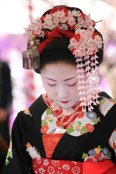 Maiko usually style their own hair and wear elaborate hair ornaments, while…