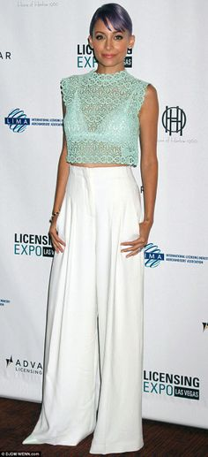 Nicole Richie flashed her white bra in a lace see-through crop top teamed with billowing dressy trousers at the Licensing Expo in Vegas http://dailym.ai/1jzptrk
