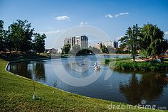 Photo about A lake in an urban park wit a swan boat floating. High rise apartment buildings in the background. Image of blue, lakeside, city - 35586247 High Rise Apartments, Urban Park, Swan, Buildings, City, Image, Swans, Cities
