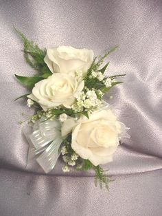 Corsage precedent - would use pink peony, gardenia and peach rose with red ribbon, silver pearls and no filler flowers...