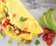 Swiss cheese, chives and avocado are a perfect combination in this bright omelette.