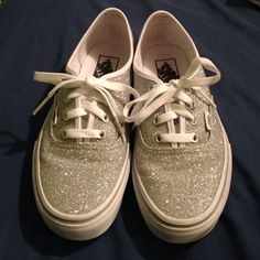 Glittery, silver and white vans These are brand new and have only been worn once. They are very comfortable and super sparkly/shiny. None of the glitter comes off !! Vans Shoes Sneakers