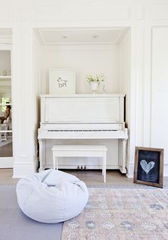A white-painted vintage piano provides a family playroom with a welcoming yet sophisticated edge. See more photos of this home at Interiors > House Tours > A Bright and Airy Vancouver Abode Layered With Texture {Photo by: Interior Design Inspiration, Decor Interior Design, Home Decor Inspiration, Interior Styling, Design Ideas, Painted Pianos, White Piano, Blogger Home, Piano Room