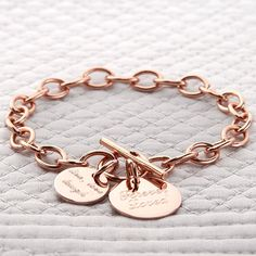 A beautiful and substantial rose gold chain bracelet with a choice of personalised disc or heart charms.