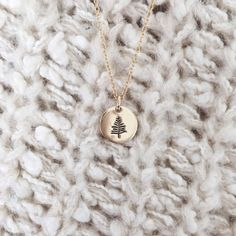 """A simple reminder to stay grounded and remain true to your roots. The Evergreen is stamped on a 3/8"""" disc. Goes great with other necklaces for a beautiful laye"""