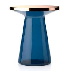 Figure is a side table made by mouth blown glass in various tones with a metal table top in several finishes. So original!  By @timelesseverydayobjects  #archiproducts