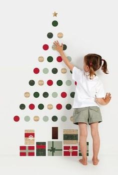 If you don't have room for a traditional Christmas tree, then consider making a wall Christmas tree! A DIY Wall Christmas Tree is a super smart way to get the… Christmas Tree Wall Decal, Diy Christmas Tree, Christmas Holidays, Christmas Decorations, Handmade Christmas, Christmas Trends, Diy Christmas Wall Decor, Christmas Stairs, Xmas Trees