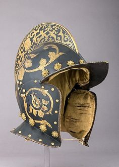 German, Ausburg Burgonet, ca. 1575-1600 Helmets of this type probably were worn by the mounted troops of the bodyguards of the prince-electors of Saxony. This helmet retains its original padded lining covered with yellow silk.