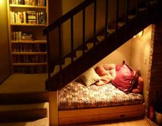 Reading nook Made UNDER Staircase. SO CLEVER! This is basically the perfect coffee and quiet time spot ever!