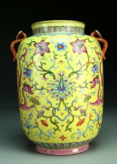 """Chinese Famille Rose Lantern Vase, Finely formed as a lantern, painted to depict pink dragons amidst lotus blossoms, scrolling tendrils, and lingzhi fungus against a graviata ground, having two ruyi shaped handles, raised on short foot ring, base having four character seal mark within double square 9.5""""H."""