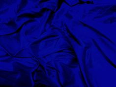 A deep blue shot-silk (royal blue shot with black). Dupioni silk, possible fabric for Madrigal's masquerade dress.