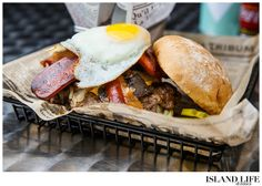 """New to Provo and only open a couple of months Big Al's has brought the classic burger bar to Turks and Caicos with a huge variety of sizes, choices and options. Big Al's """"ultimate""""  -this burger is just how it sounds. Served with grilled onions, mushrooms, bacon, cheese, grilled hot dog and a fried egg! Come hungry! #turks #caicos #turksandcaicos #islandlifeandtimes www.islandlifeandtimes.com"""