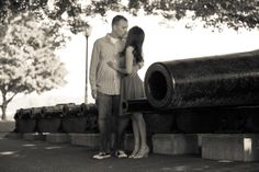 A couple kissing by a canon. Copyright Photographics Solution 2013