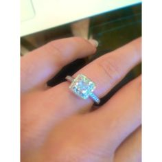 Stunning cushion cut diamond with halo dream ring