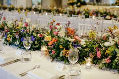 Rainbow floral runner centrepiece by Lola Mai Floral Styling #weddingstyle #flowers // Photos by Lara Hotz Photography