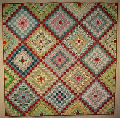 I made this one a couple of summers ago. It's the first quilt I ever sent out to have machine quilted. I'm a die hard hand quilter but have realized that I will never in my lifetime hand quilt all of the quilts that I want to make.