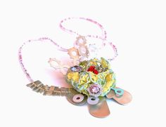 Donning Oxford: SALLY COLLINS-UK : Necklace: 'Electric Bloom' 2011-12  7x 11x 3cm (Chain 66cm in length)  Sterling silver, cubic zirconia, swarovski crystals, cotton, paint