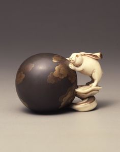 Hare with pestle and globe. Made of lacquered ivory. Japan