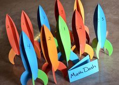 Rocket Ship Carnival Classroom Games using Ellison Die Cut rocket ships - with a great educational spin! Math Dash, meteor throw, space race and more!