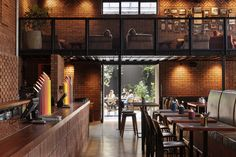 Material Creative conceived a 'trusty neighborhood watering hole' in Morningside Tavern on Auckland's city fringe, championing the predominant use of brick. Brick Interior, Interior Design, Concrete Slab, Cool Cafe, Cafe Design, Auckland, Design Awards, Retail Design, Restaurant Design