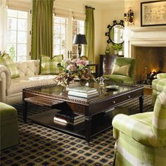 What a great room - trying to decide how much green I really want in my house, but I love that this feels fresh and cozy at the same time.  I could even get on board with carpet!