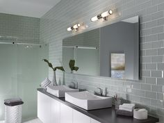 The key to great bathroom lighting might be more detailed than you think. No modern bathroom would feel complete without a setup that involves multiple light sources and layers. Whatever your design style, we have a quick pocket guide to … Bathroom Lights Above Mirror, Bathroom Vanity Lighting, Mirror Bathroom, Glass Subway Tile, Glass Tiles, Bath Tiles, Mosaic Tiles, Shower Surround