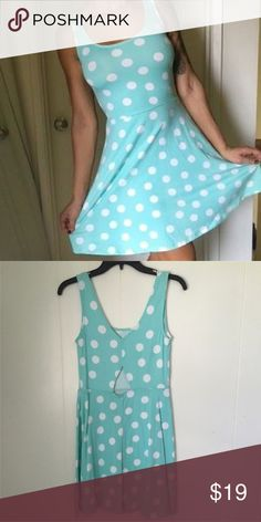 Blue Polka Dot Dress Adorable and bright Mossimo polkadot skater dress. Baby blue with white polkadots, soft and stretchy fabric, round neck, open triangle detail on back. Worn once. Mossimo Supply Co Dresses Mini