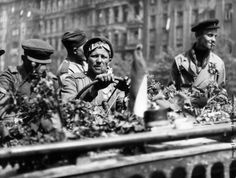 Soviet troops at the wheel of a flower bed-decked jeep as they enter Prague after it had been liberated by Czech patriots. (Photo by Keystone/Getty Images). 05-1945