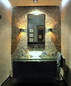 The soffit lighting does a wonderful job highlighting the accent stone and Venetian plaster walls in this beautiful powder room. The custom vanity with a floating glass top and metal floor tiles from Walker Zanger add the finishing touches. Modern Powder Rooms, Modern Room, Modern Bathroom, Small Bathroom, Ideal Bathrooms, Beautiful Bathrooms, Bathroom Wall, Bathroom Interior, Bathroom Ideas