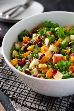 This Fall Harvest Salad is full of fall flavors; roasted butternut squash, tender wild rice, pepitas, sweet apples, and hearty kale.