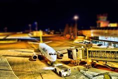 """""""Let's Play"""" by Vladislavs Punculs. Great command over tilt-shift distortion makes this airport scene seem as if it's shot with toys."""