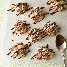 Zesty orange peel livens up this crisp chocolate macaroon recipe, while a drizzle of chocolate sauce adds rich decadence.