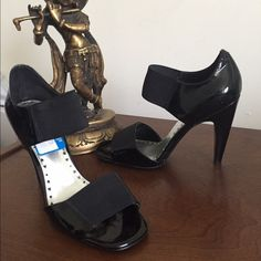 BCBG size 6 black patent heels NWT Super cute BCBG heels with elastic straps. 4in heels. Clearance tag still attached never worn. Comfortable and looks great with anything. BCBG Shoes Heels