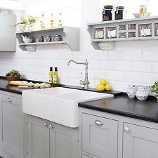 gray kitchen w/black countertops upper shelves for temporary, farmhouse sink