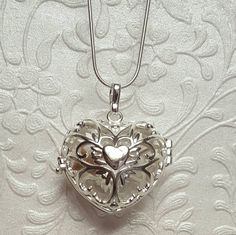 Hey, I found this really awesome Etsy listing at https://www.etsy.com/listing/246199145/heart-memorial-locket-with-glass-ash-orb