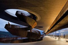 A soaring corkscrew staircase of steel is a centerpiece of the new headquarters of the winemakers Antinori in Bargino, Italy, by the Florence architecture firm, Archea.