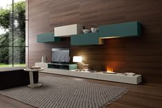 PRESOTTO | Base units and wall unit in matt beige seta lacquer, wall units and open electronic equipment housing unit in matt verde ossido lacquer. The electric fireplace is recessed into the base unit.__ Basi ed elemento pensile in laccato opaco beige seta, elementi pensili ed elemento a giorno porta apparecchi elettronici in laccato opaco verde ossido. Camino elettrico incassato su base.