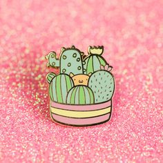 Where has my little kitty gone??? The kitty has found a new hiding place! Carry this cute little kitty hiding in some cacti everywhere you go! This is a hard enamel pin and has a gold finish. The pin measures about 1 inch tall and 1 inch wide and comes packaged with a black rubber pin back
