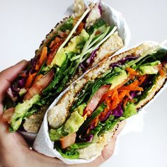 "shana-makins: "" Salad Sandwich: • Lettuce • Spinach Leaves • Tomato • Avocado • Spring onion • Carrot • Purple Cabbage • Cucumber • Sprouts """