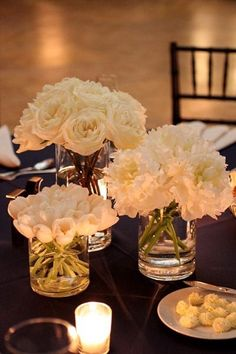 Absolutely love this idea for the centerpieces! Love the vases, the same flowers in each vase, and the tea lights as well! Pretty!